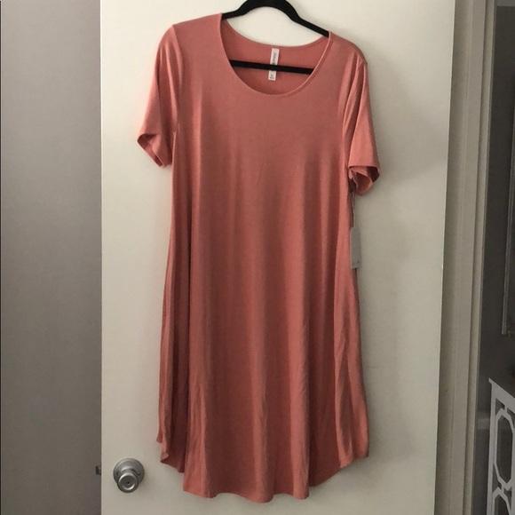 c6e8ac8e4533 Rose pink short sleeves swing dress with pockets. M_5b8d7584d6716a270785e05b